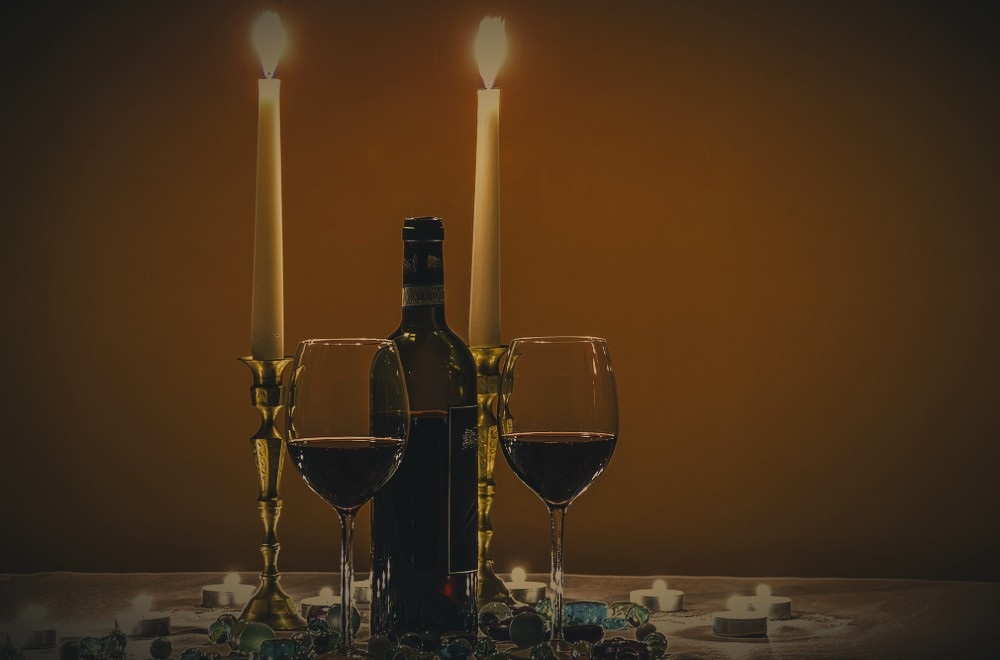 Victorian Romantic Dinner with candles and wine
